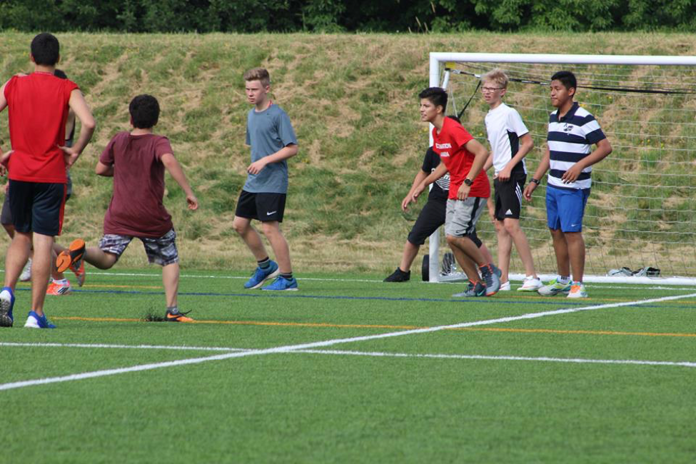 Campers at Destination Canada play soccer on the beautiful Carleton University campus