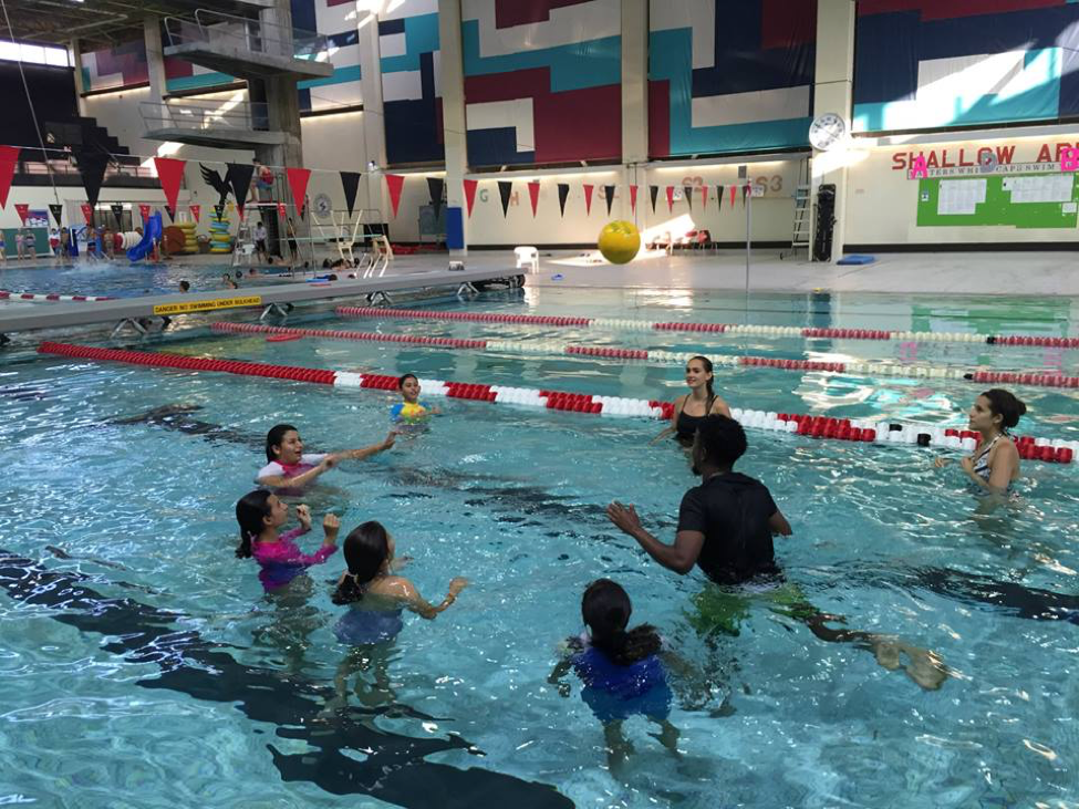 Campers play a water game in Carleton's Olympic-sized pool