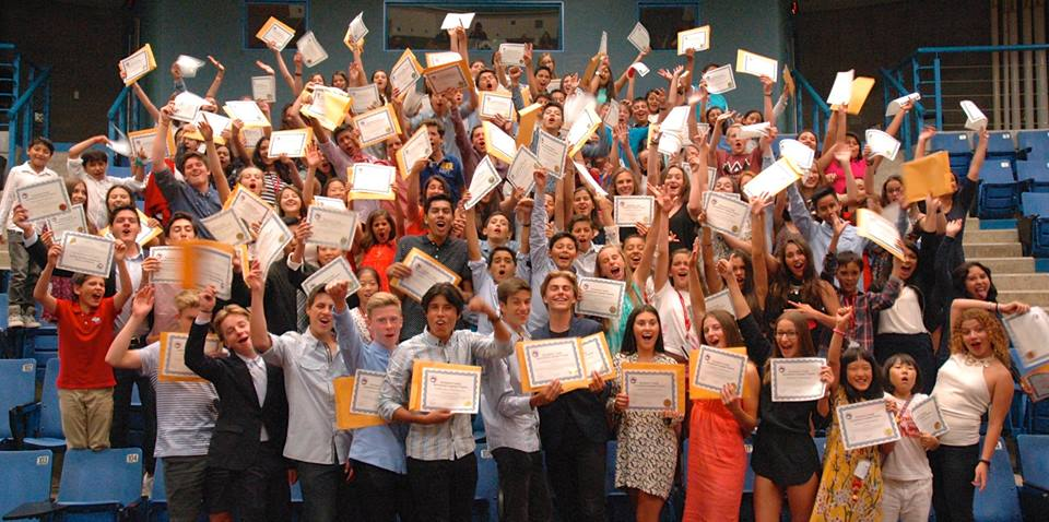 Destination Canada campers show off their certificates during their graduation ceremony