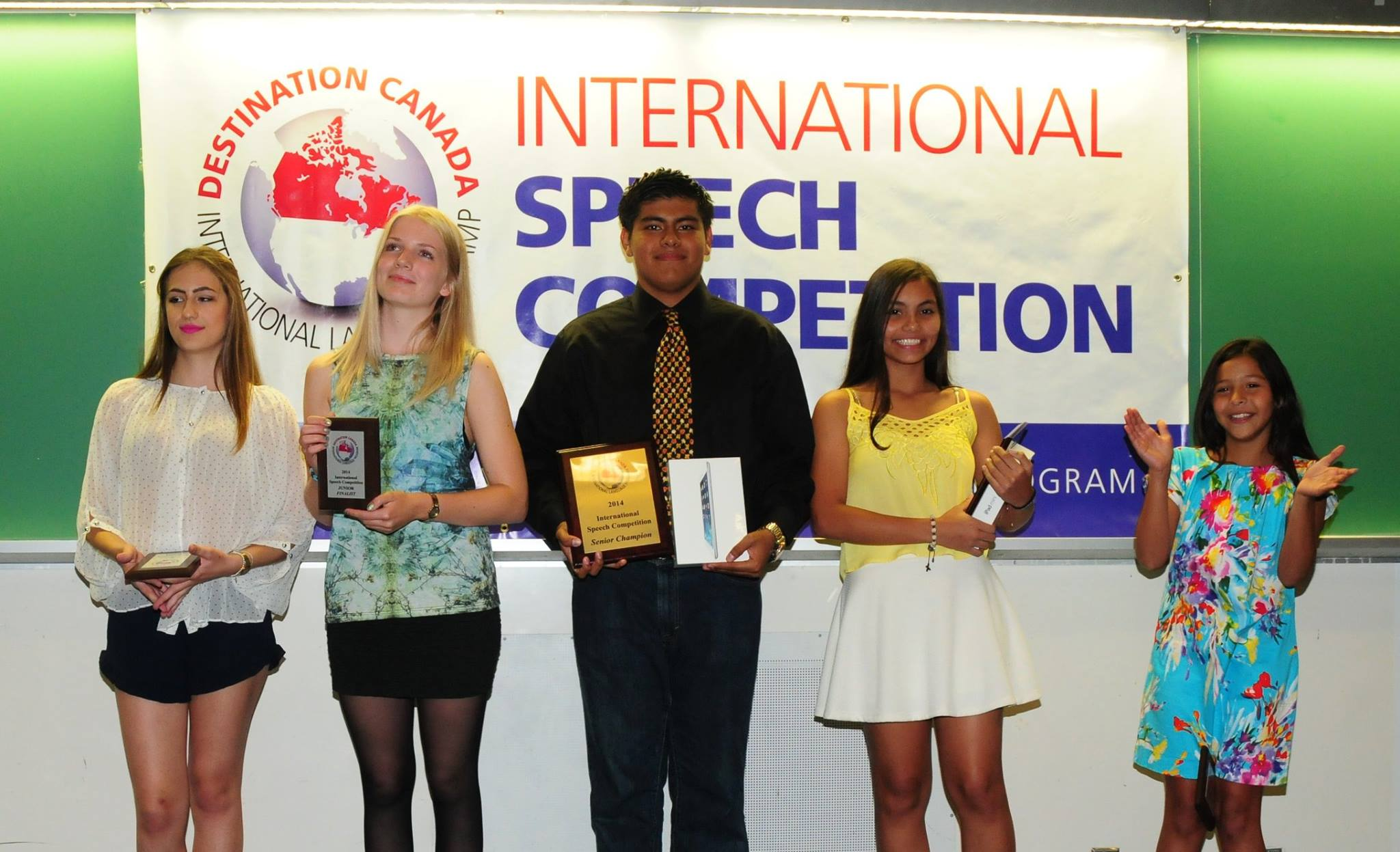 Winners stand with their certificates & prizes at Destination Canada's International Speech Competition