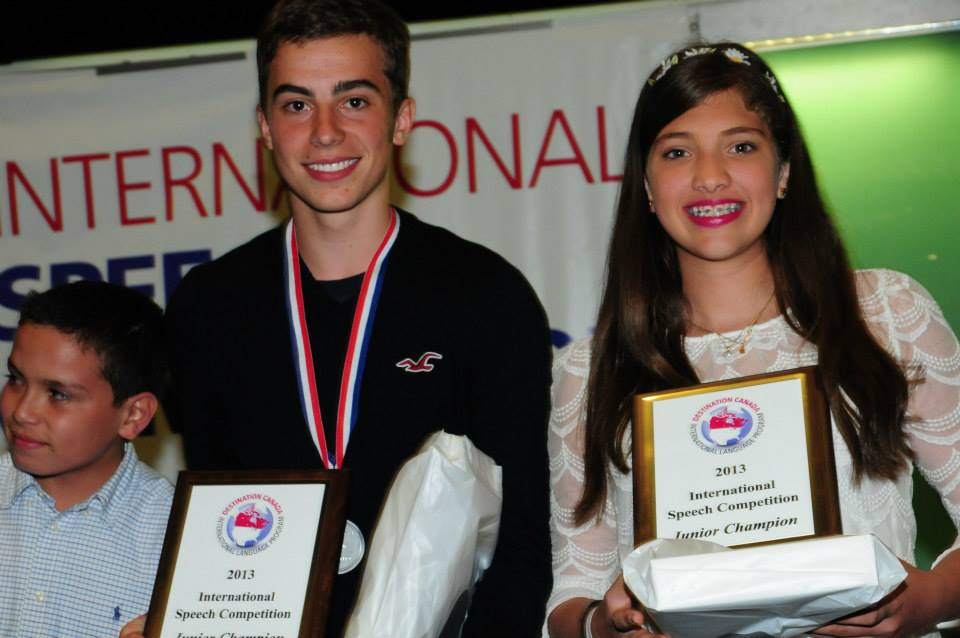 Winners stand with their awards at Destination Canada's International Speech Competition