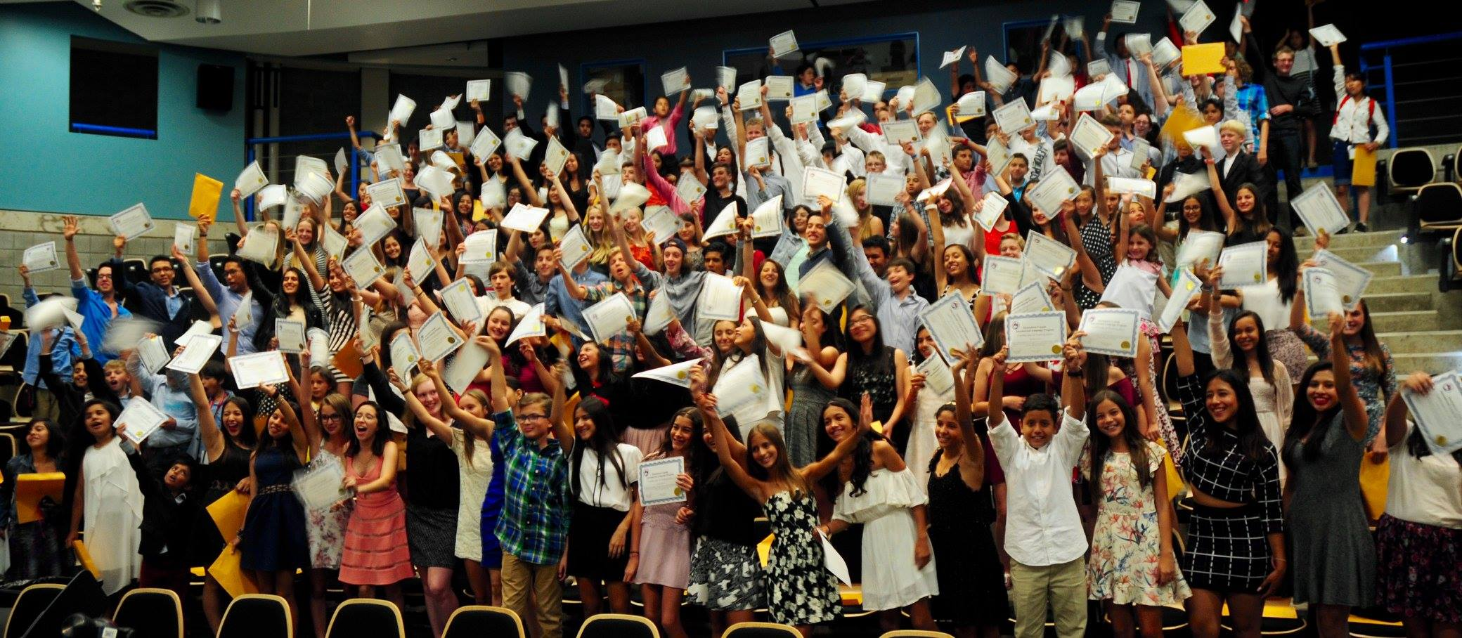 Students at Destination Canada celebrate their accomplishments at their graduation ceremony