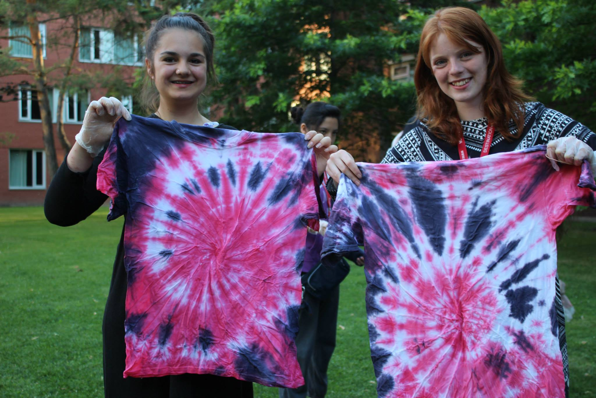 Kids tie dye their team colours as they take part in Destination Canada's Olympic activities